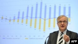 Архивска фотографија: Eврокомесарот за економска и монетарна политика, Оли Рен.