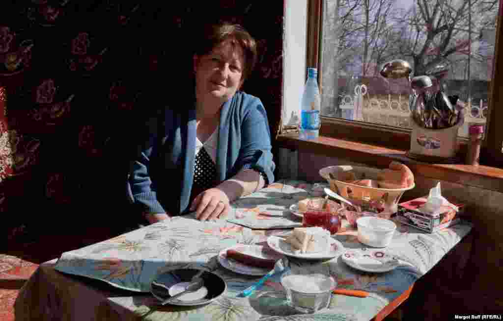 Asmik Saryan, a doctor, serves breakfast in the guesthouse that she runs with her husband, Saro, for a slowly growing number of tourists in Shusha.