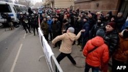 A Russian protester throws a stone towards the Turkish embassy in Moscow on November 25. The recent downing of a Russian warplane by a Turkish jet has caused widespread anger in the country.