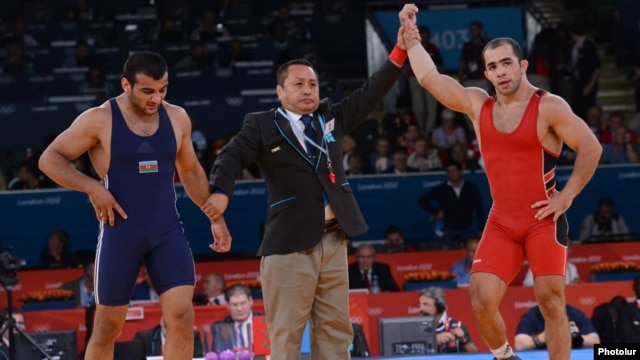 """No matter how much they say that there will be equal conditions, it is one thing to say it and another thing to do it,"" says Armenian wrestler Arsen Julfalakian (right), an Olympic silver medalist."