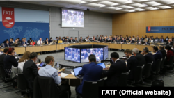 FILE - The first FATF Plenary meeting under the US Presidency in Paris. October 19, 2018.