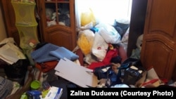 """When I returned home, I simply couldn't recognize anything,"" Vika's mother, Zalina Duduyeva, told RFE/RL. ""Everything was broken. Anything of value was missing. The floor was littered with used condoms."""
