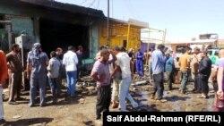 На місці вибуху на базарі міста Аль-Кут, 16 червня 2013 року