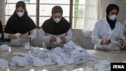 Line production of masks set up in Iran following the outbreak of coronavirus, February 2020.