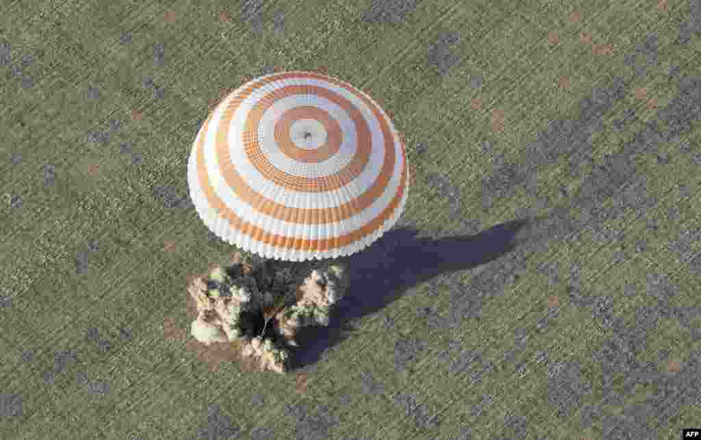 One small steppe for man: The Soyuz capsule is captured at the moment of touchdown near the town of Arkalyk in central Kazakhstan on September 17.