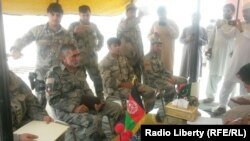 Pakistani and Afghan border authorities hold a meeting at the Chaman border crossing on August 31.