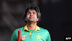 FILE: Ahmed Shehzad of Pakistan walks off after being dismissed during the second Twenty20 cricket match between New Zealand and Pakistan.