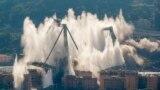 Италиянын Генуя шаарындагы көпүрөнүн түркүктөрүн жардырган кезде асманга көтөрүлгөн чаң. 28-июнь.