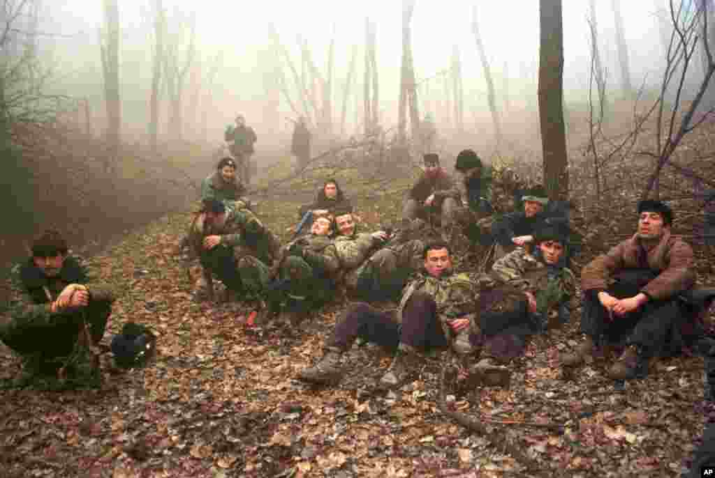 Chechen fighters resting in a forest near Grozny in December 1999.