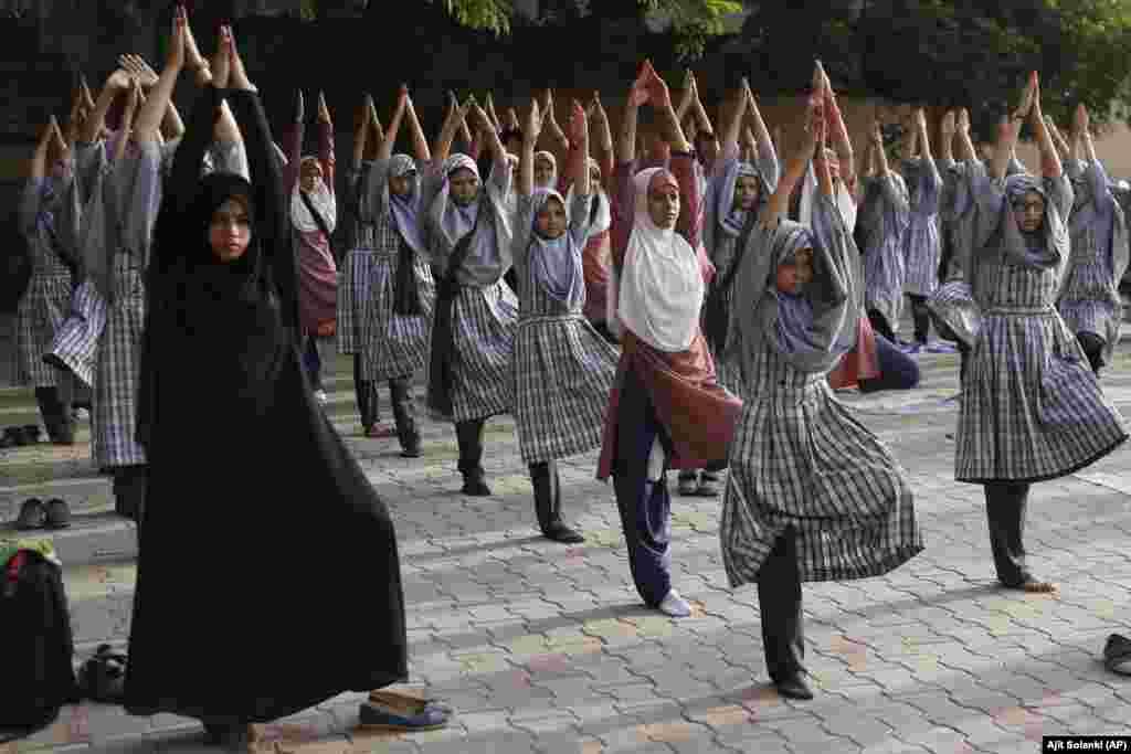 Indian Muslim students practice yoga ahead of International Yoga Day at a school in Ahmadabad. International Yoga Day will be celebrated on June 21. (AP/Ajit Solanki)