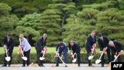 G7 leaders take part in a tree-planting ceremony on the grounds at Ise-Jingu Shrine in the city of Ise on May 26. (Left to right: Italian Prime Minister Matteo Renzi, German Chancellor Angela Merkel, U.S. President Barack Obama, Japanese Prime Minister Shinzo Abe, French President Francois Hollande, U.K. Prime Minister David Cameron, Canadian Prime Minister Justin Trudeau, and European Commission President Jean-Claude Juncker)