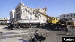Pamje nga një qytet në Siri, pas shpërthimit të një bombe