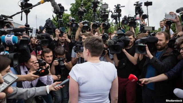 Nadia Savchenko speaks to reporters after her liberation from a Russian prison and return to Kyiv on May 25.