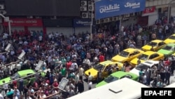Iranian protestors shout slogans as they gather at a street close to the Bazaar in Tehran, Iran, 25 June 2018