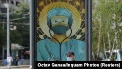 Один із плакатів, які викликали обурення православної церкви в Румунії, Бухарест, 29 квітня 2020 року