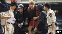 Alleged Russian arms dealer Viktor Bout arrives at his hearing at the Criminal Court in Bangkok.