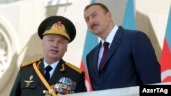 Defense Minister Safar Abiyev (left) and President Ilham Aliyev at a military parade in Baku in June 2011