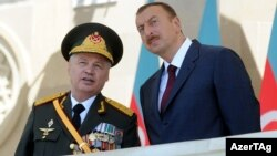 Azerbaijan – Defense Minister Safar Abiyev (L) and President Ilham Aliyev at a military parade in Baku to mark 93rd anniversary of Armed Forces, 26Jun2011