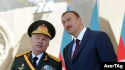 The most notable change in the new cabinet is the absence of Safar Abiyev (left, seen with President Ilham Aliyev at a military parade in 2011), who has served as defense minister.