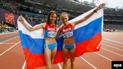 Russia's Mariya Savinova (keft) and Ekaterina Poistogova celebrate after placing first and third, respectively, in the women's 800-meters final at the 2012 Summer Olympics in London. The two athletes are being targeted for lifetime competition bans.