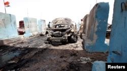 Багдаддын түндүгүндөгү Рашидия районунундагы жардырылган унаа. Ирак, 13-июль, 2016.