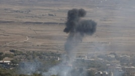 Smoke rises after an explosion in the Syrian village of Bariqa close to the cease-fire line between Israel and Syria.
