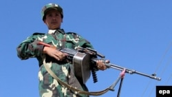 An Afghan National Army soldier stands guard at the Pakistan-Afghanistan border