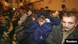 Foto e qytetarëve rus të cilë u larguan nga Siria gjatë muajit janar me ndihmen e disa aeroplanëve