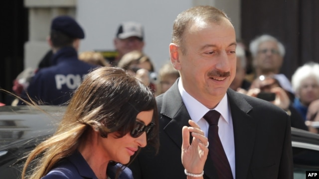 Azerbaijani President Ilham Aliyev (right) and his wife, Mehriban Aliyeva, arrive for a visit to Vienna last month.