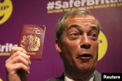 UKIP leader Nigel Farage holds his passport at a pro-Brexit event in London earlier this month.