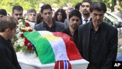 Mourners push the coffin of Bano Abobakar Rashid, 18, the first victim of the shooting rampage at Utoeya to be buried, during her funeral at a church in Nesodden on July 29.