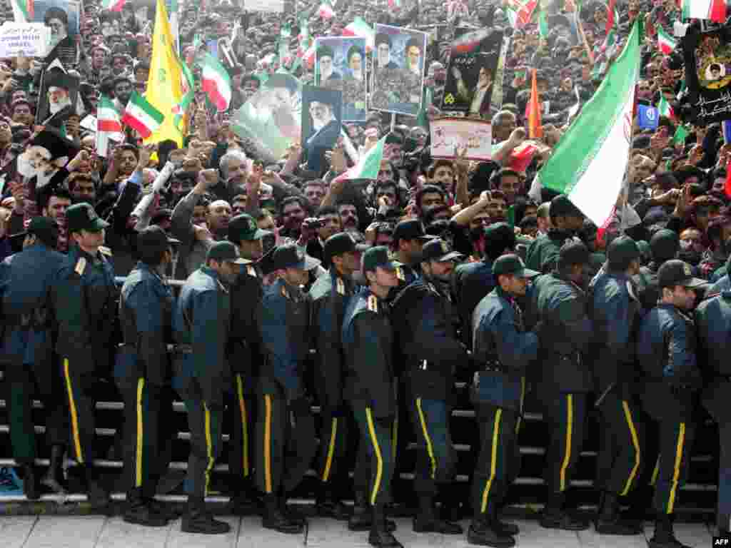 Iranian security forces deployed as part of celebrations marking the 31st anniversary of the Islamic Revolution. - Opposition leaders are reported to have come under attack and their supporters clashed with police during the rallies.