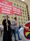 Georgian police detained at least eight people after conservative activists faced off against gay and lesbian protesters in Tbilisi on June 14.