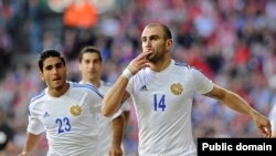 Yura Movsisyan (right) played for Armenia against Denmark in June 2013.