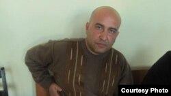 Задержанный капитан милиции Кудрат Хомидов