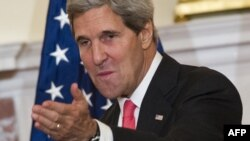 U.S. Secretary of State John Kerry is pressing the UN Security Council to pass a resolution including the threat of force if Syria fails to abide by a U.S.-Russian plan to place its chemical weapons under international control.
