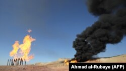 Gas flares at the Havana oil field, west of the northern Iraqi city of Kirkuk