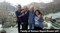 A photo provided by the family of the late Iranian-Canadian professor Kavous Seyed-Emami, shows him (2nd R), his wife, Maryam Mombeini (R) and their two sons at an unidentified place in Iran, undated