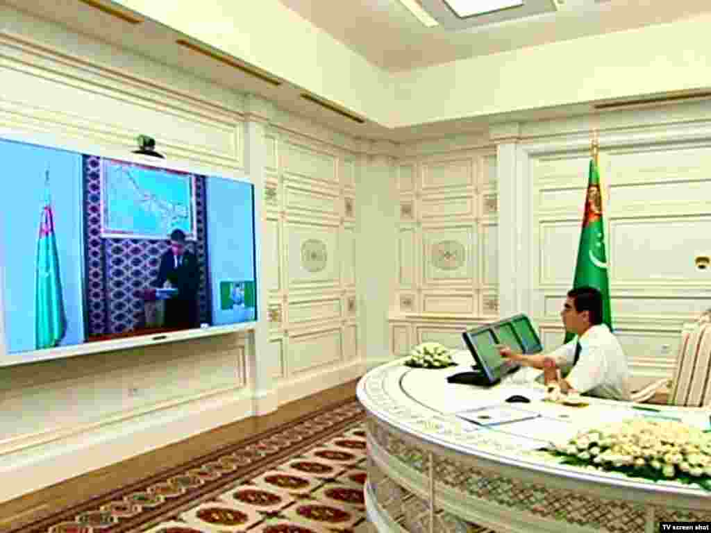 Berdymukhammedov participating in a government video conference from his presidential office. Even the traditional Turkmen carpet, usually woven in a range of reds, has been adapted to reflect the president's predilection for white.