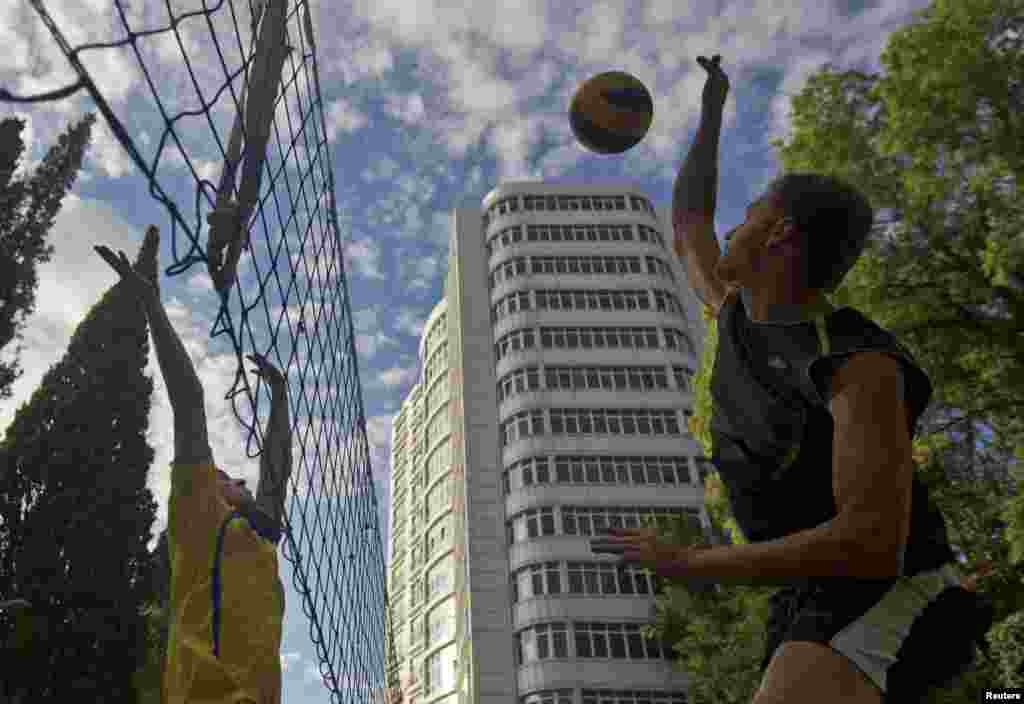 A game of volleyball in a park in Sochi