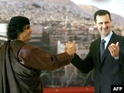 Президент Сирии Башер Ассад с Муммаром Каддафи на открытии сессии арабского саммита. Дамаск, 29 марта 2008 года.