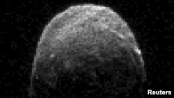 "A NASA image of the asteroid ""2005 YU55"""