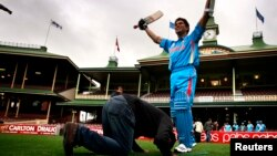 A cricket fan pays homage to a wax figure of Sachin Tendulkar at the Sydney Cricket Ground earlier this year.