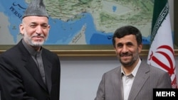 Iranian President Mahmud Ahmadinejad (right) and Afghan President Hamid Karzai in Tehran in May 2009