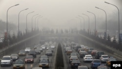 A main road leads into the haze in Beijing, China.