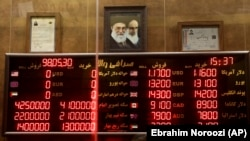 IRAN -- Various rates and prices for currencies and gold coins are displayed at an exchange bureau, in Tehran, August 21, 2019