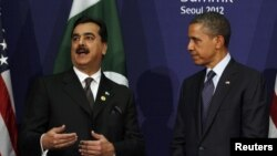 Юсаф Раза Ґілані й Барак Обама під час зустрічі у Сеулі