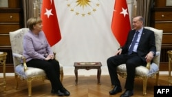 Turkish President Recep Tayyip Erdogan (right) meets with German Chancellor Angela Merkel in Ankara on February 2.