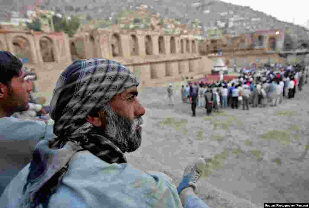 "Afghans watch ""Love's Labour's Lost"" in the ruins of the royal palace in Kabul."