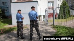 Belarusian police arrive at the office of the BelaPAN news agency in Minsk on August 7.